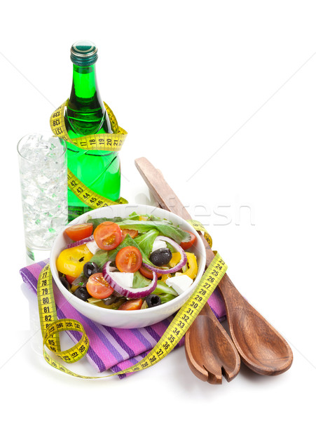 Fresh healthy salad, glass of water and kitchen utensil Stock photo © karandaev