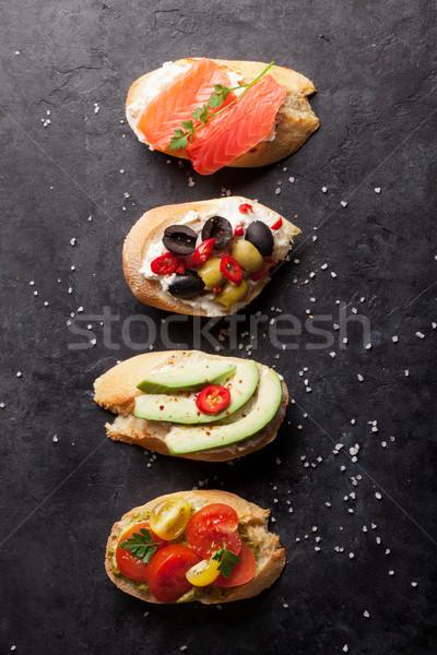 Toast kanapki awokado pomidory łososia oliwek Zdjęcia stock © karandaev