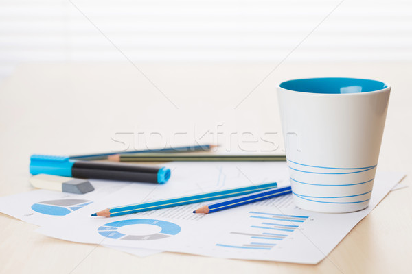 Office workplace with coffee, supplies and reports Stock photo © karandaev