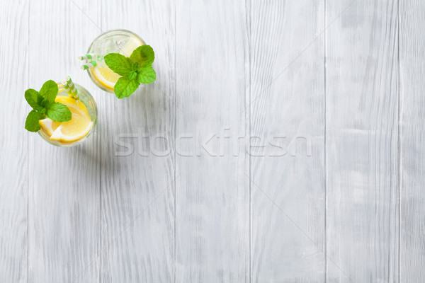 Limonade Gläser Zitrone mint Eis Holztisch Stock foto © karandaev