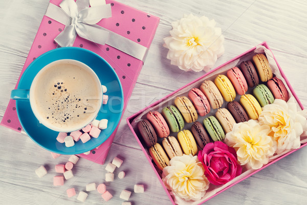 Macaroons and coffee. Sweet macarons in gift box Stock photo © karandaev