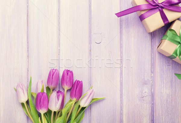 Purple tulip bouquet and gift boxes Stock photo © karandaev