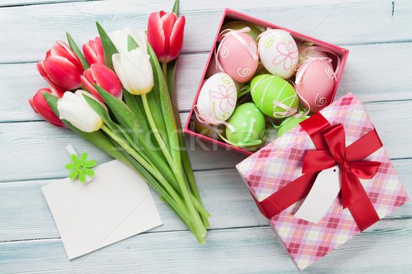 Easter eggs tulipani bouquet colorato legno top Foto d'archivio © karandaev