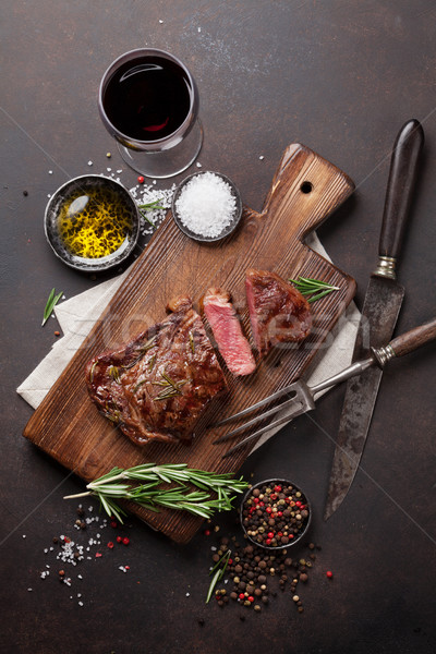 Grilled ribeye beef steak with red wine, herbs and spices Stock photo © karandaev