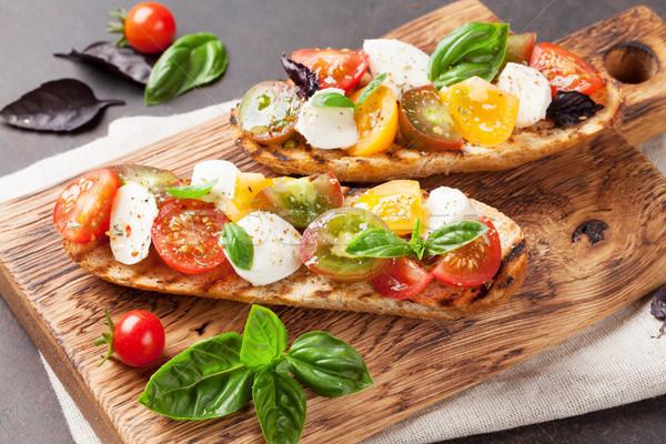 Bruschetta domates mozzarella fesleğen kiraz domates Stok fotoğraf © karandaev