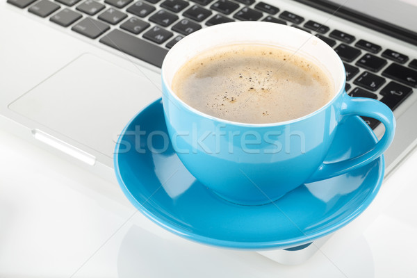 Blue coffee cup and laptop Stock photo © karandaev