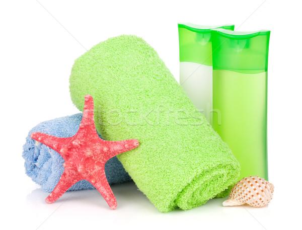 Bad flessen handdoek zeester geïsoleerd witte Stockfoto © karandaev