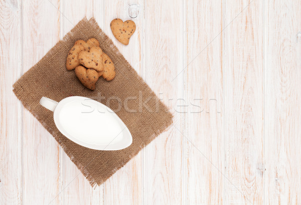 Jug of milk and heart shaped cookies Stock photo © karandaev