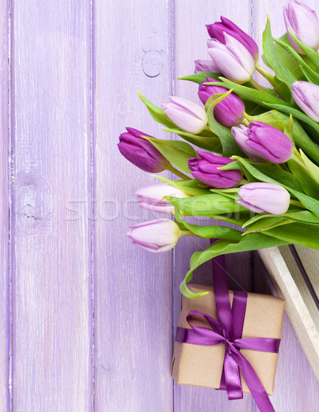 Purple tulips and gift box over wooden table Stock photo © karandaev