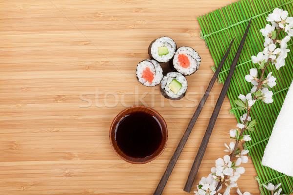 Stock photo: Sushi maki set with fresh sakura branch