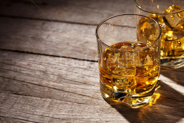Glasses of whiskey with ice on wood Stock photo © karandaev