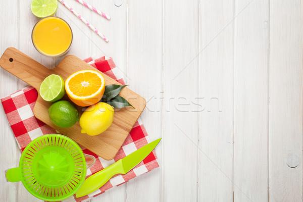Citrus fruits and glass of juice. Oranges, limes and lemons Stock photo © karandaev