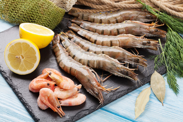 Fresh raw tiger prawns and fishing equipment Stock photo © karandaev