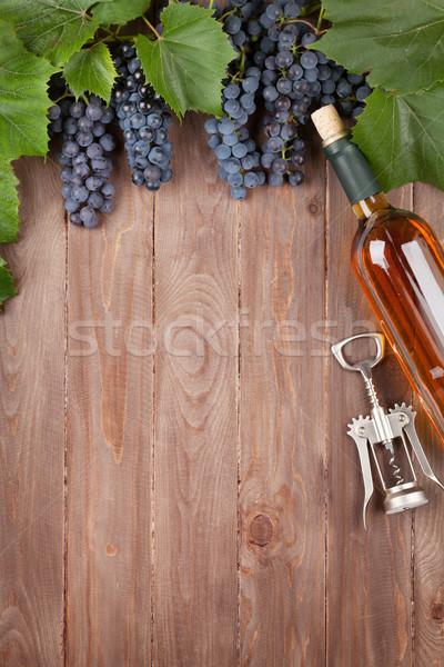Red grape, wine bottle and corkscrew Stock photo © karandaev
