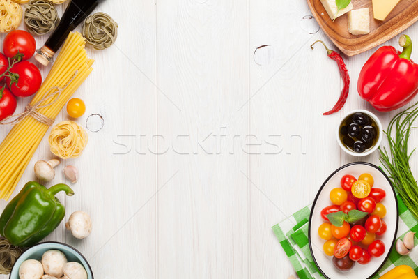 Italian food cooking ingredients. Pasta, vegetables, spices Stock photo © karandaev