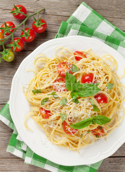 Spaghetti pasta with tomatoes and basil Stock photo © karandaev