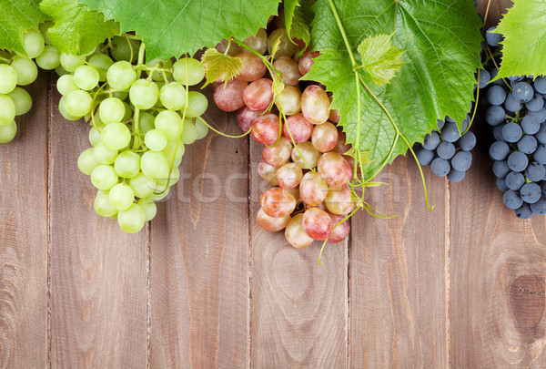 Bunch of grapes on wooden table Stock photo © karandaev
