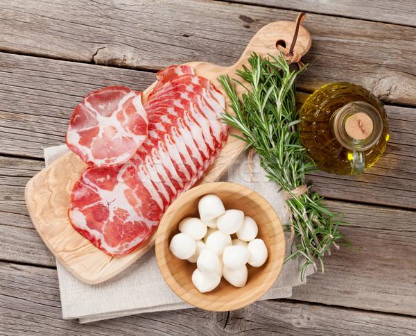 Prosciutto mozzarella fa asztal felső kilátás étel Stock fotó © karandaev