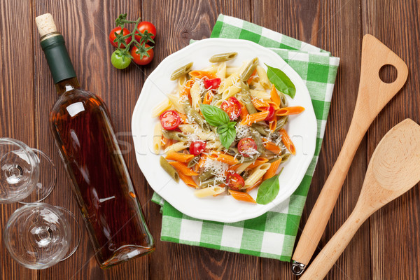 Stock photo: Colorful penne pasta and white wine