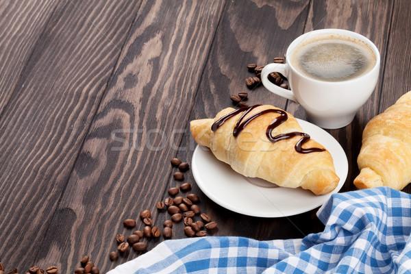свежие круассаны кофе деревянный стол мнение копия пространства Сток-фото © karandaev