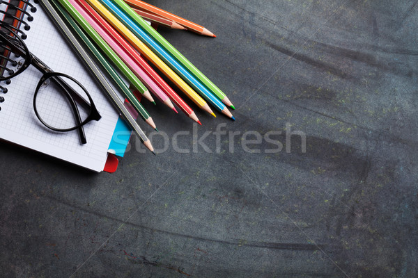 Notepads and supplies over chalk board Stock photo © karandaev