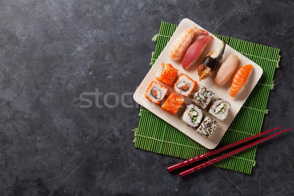 Set sushi maki rotolare pietra tavola Foto d'archivio © karandaev