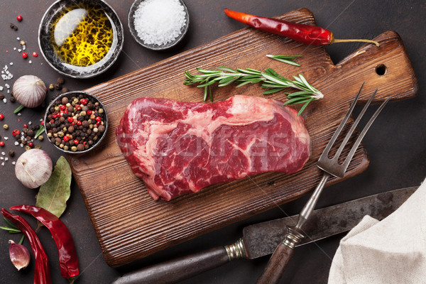 Raw ribeye beef steak cooking with ingredients Stock photo © karandaev