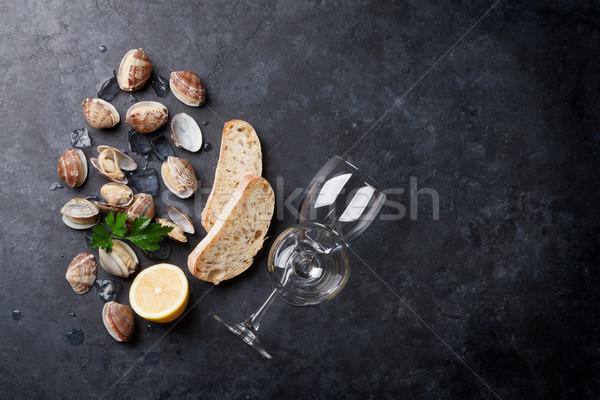 Fresh seafood and white wine. Scallops and wine glasses Stock photo © karandaev