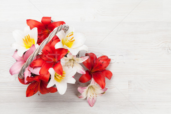 Stock photo: Colorful lily flowers basket