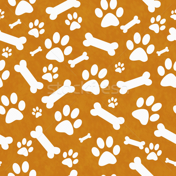 Orange and White Dog Paw Prints and Bones Tile Pattern Repeat Ba Stock photo © karenr