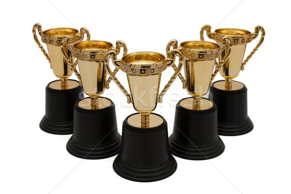 Sempre vitória cinco ouro troféus isolado Foto stock © karenr