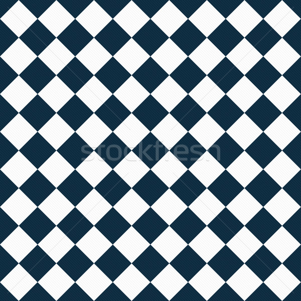 Stock photo: Navy Blue and White Diagonal Checkers on Textured Fabric Backgro