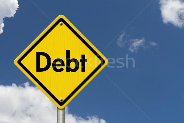 Dívida aviso placa sinalizadora amarelo cautela assinar Foto stock © karenr