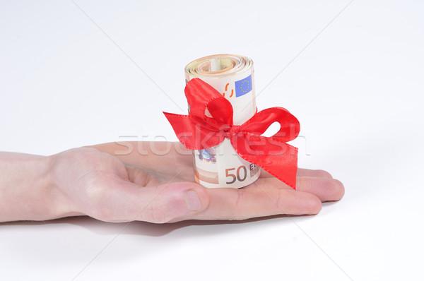 Argent monétaire cadeau Finance euros ruban Photo stock © karin59