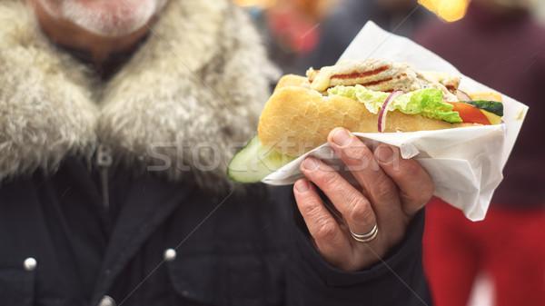 Sandwich in the man`s hands. Street food. Stock photo © Karpenkovdenis