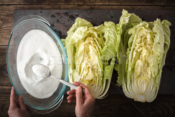 Salt, the two halves of Chinese cabbage to cook kimchi on slate Stock photo © Karpenkovdenis