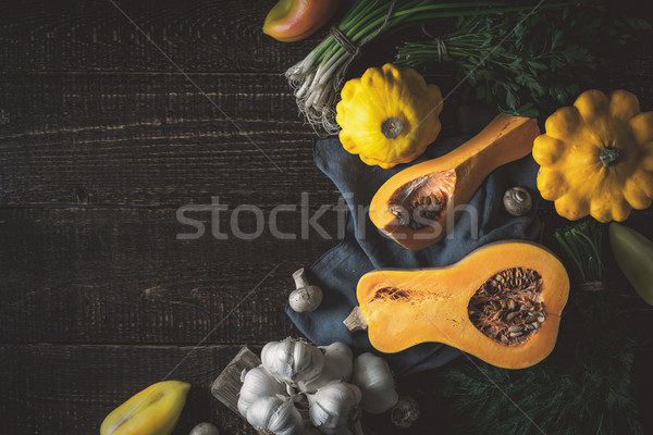 Pumpkin with different vegetables  at the right of the  wooden table Stock photo © Karpenkovdenis