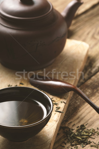 Chinese bowl with tea on the wooden table vertical Stock photo © Karpenkovdenis