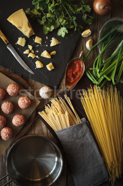 Ingredients for cooking spaghetti, meatballs with cheese and fresh herbs Stock photo © Karpenkovdenis
