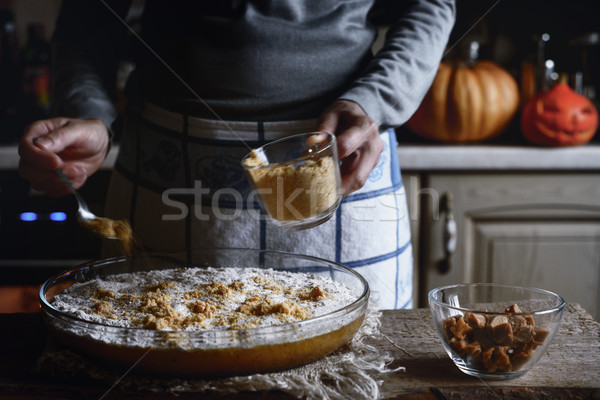 Adding cracker crumbs in the dough for pumpkin dump cake Stock photo © Karpenkovdenis