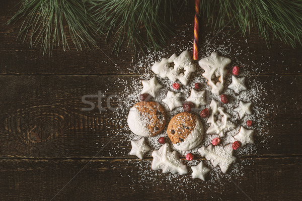Christmas ball made by  cookies and berries on the wooden background  top view Stock photo © Karpenkovdenis