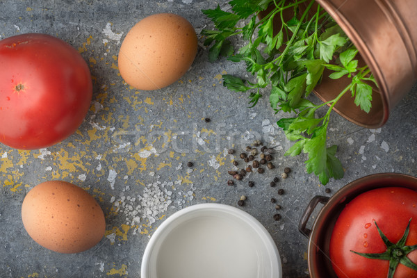 Ingredients for baked eggs with tomatoes  on the stone table top view Stock photo © Karpenkovdenis