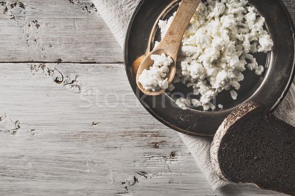 Fresh cottage cheese on the  metal plate  with bread on the white wooden table horizontal Stock photo © Karpenkovdenis