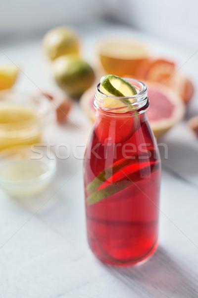 Citrus juice on the white wooden table vertical Stock photo © Karpenkovdenis