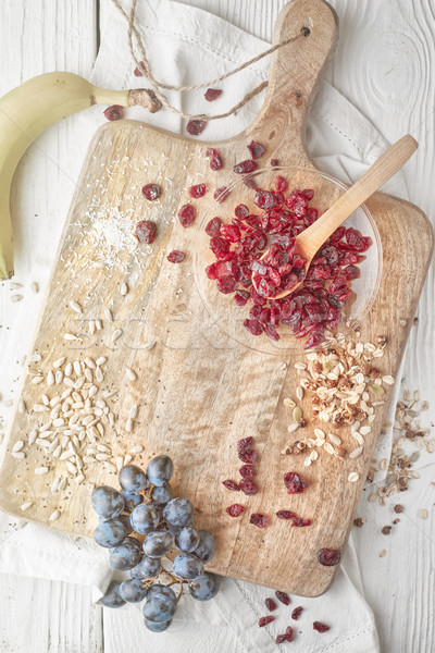 Dried cranberries  with cereal and fruits on the  white wooden table top view Stock photo © Karpenkovdenis