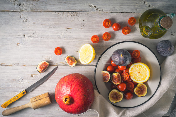 Ingredients for fruit salad with tomatoes on the white wooden table Stock photo © Karpenkovdenis
