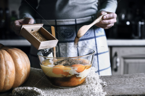Adding spices in the glass bowl with in the dough for pumpkin dump cake Stock photo © Karpenkovdenis
