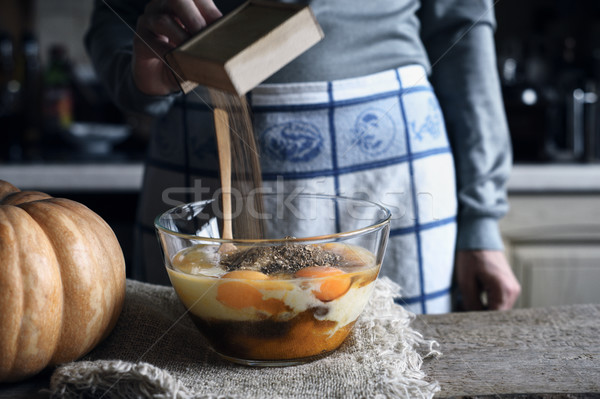 Adding spices in the dough for pumpkin dump cake horizontal Stock photo © Karpenkovdenis