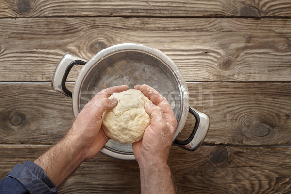 Man makes the dough in the pan Stock photo © Karpenkovdenis