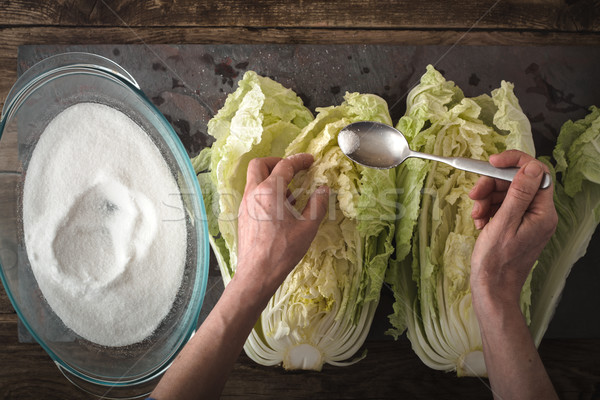 Dropping salt leaves Chinese cabbage to cook kimchi on slate Stock photo © Karpenkovdenis